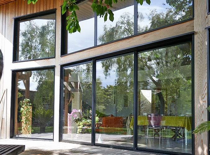 Porte-fenetre baies vitrées grandes ouvertures aluminium réalisation pasquet menuiseries 1